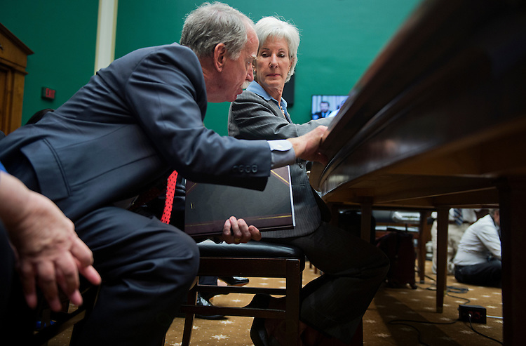 UNITED STATES - OCTOBER 30: HHS Secretary Kathleen Sebelius talks with and aide after testifying before a House Energy and Commerce Committee hearing in Rayburn Building on the failures of Affordable Care Act's enrollment website. (Photo By Tom Williams/CQ Roll Call)