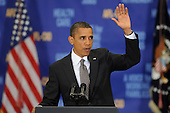 United States  President Barack Obama waves after delivering remarks on the economy to the American Federation of Labor and Congress of Industrial Organizations (AFL-CIO) Executive Council Meeting at the Washington Convention Center, in Washington DC, USA, Wednesday, 04 August 2010. President Obama outlined efforts by his administration to steer the nation out of an economic downturn and further action required to recover the 8 million jobs lost during the current recession.  .Credit: Michael Reynolds - Pool via CNP
