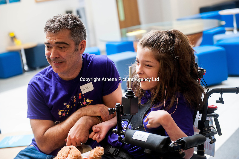 COPY BY TOM BEDFORD<br /> Pictured: Dad Rob and Poppy prior to the Race Sunday 26 June 2016<br /> Re: A very special father-and-daughter team have tackled the Cardiff Triathlon.<br /> Poppy Jones, 11, who will be competing alongside dad Rob Jones, wants to win the event.<br /> And she's not going to let the fact that she has quadriplegic cerebral palsy , which means she can't sit, stand, roll or support herself, and chronic lung disease stop her.<br /> She will be by Rob's side every step of the way thanks to a cutting-edge wheelchair and boat – for Rob to push or pull – designed especially for the event, which sees participants take part in a swim across Cardiff Bay , a run and a bike ride.