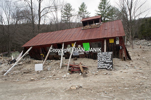 """We Lost Everything"" states the sign left by the owners. The remains of a Sugaring House and the washed out hillside are seen along route 100 in southern Vermont on April 11, 2012 almost a year after tropical storm ""Irene"" hit Vermont."