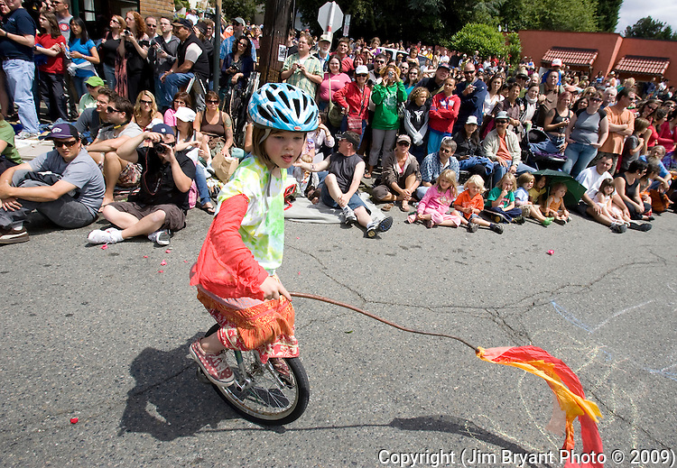 Megan Brown entertains the crowed during the 21st  Annual Fremont Summer Solstice Parade in Seattle on June 21, 2009. The parade was held Saturday, bringing out painted and naked bicyclists, bands, belly dancers and floats. (Jim Bryant Photo © 2009)