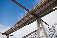 Empty cod stockfish drying racks in winter, Steine, Vestvagoy, Lofoten islands, Norway