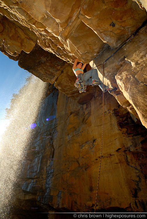 Jen Sauer climbs underneath a waterfall in Tennessee.