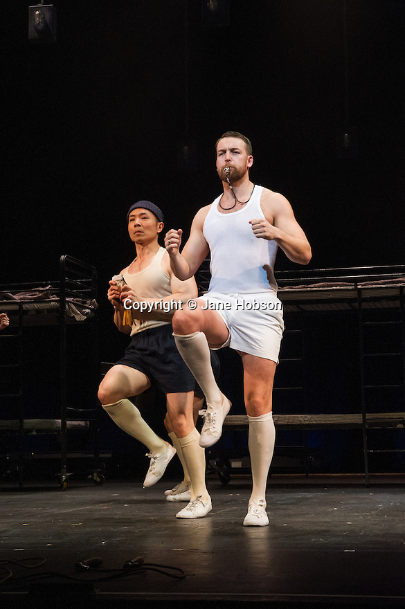 London, UK. 14.02.2014. Regan de Wynter Ltd, in association with Hilary A Williams present Gilbert and Sullivan's HMS PINAFORE, at the Hackney Empire from Friday 14th to Sunday 23rd February, prior to an 8 week UK tour. Picture shows: Benjamin Wong (ensemble) and Neil Moors (Captain Corcoran). Photograph © Jane Hobson.