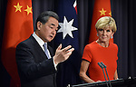 Chinese Foreign Minister Wang Yi (L) speaks during a press conference with Australian Foreign Minister Julie Bishop (R) at Parliament House Canberra, Tuesday Feb 7, 2017. AFP PHOTO/ MARK GRAHAM