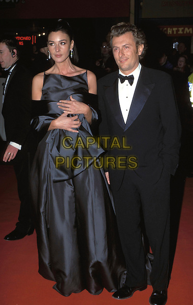 MONICA BELLUCCI & GUEST.Bafta Awards Arrivals, London, UK..February 25th, 2001.Ref: 10401.baftas full length grey gray satin dress gown tuxedo.www.capitalpictures.com.sales@capitalpictures.com.©Adam Houghton/Capital Pictures