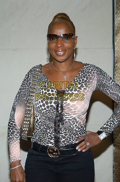 MARY J. BLIGE.Roberto Cavalli unveils his Beverly Hills Boutique on Rodeo Drive with a private party to benefit Race to Erase MS at the Roberto Cavalli Boutique. Beverly Hills, California .February 15th, 2005.half length animal print leopard print black and white top sunglasses shades hand on hip ring.www.capitalpictures.com.sales@capitalpictures.com.© Capital Pictures.