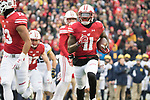 Wisconsin Badgers punt returner Nick Nelson (11) returns a punt for a touchdown during an NCAA College Big Ten Conference football game against the Michigan Wolverines Saturday, November 18, 2017, in Madison, Wis. The Badgers won 24-10. (Photo by David Stluka)