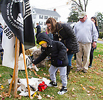 MIDDLEBURY, CT - 05 NOVEMBER 2016 - 110516JW02.jpg -- Nicole Mannetti with her son Ryan Mannetti sprinkle tobacco leaves into a burning brazierduring the ceremony of the Native Indian Veterans Blessing on the Middlebury Town Green Saturday afternoon.    Jonathan Wilcox Republican-American