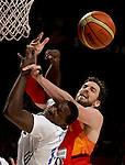 France's forward Florent Pietrus vies with Spain's forward Pau Gasol during the 2014 FIBA World basketball championships quarters of final match Spain vs France at the Palacio de los Deportes in Madrid on September 10, 2014.  PHOTOCALL3000 / DP