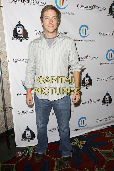 "KEVIN RAHM.Children's Institute Hosts ""Poker For A Cause"" Celebrity Poker Tournament held At Commerce Casino Hotel, City Of Commerce, California, USA..October 17th, 2009.full length striped stripes blue jeans denim.CAP/ADM/KB.©Kevan Brooks/AdMedia/Capital Pictures."
