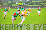 St Michaels/Foilmore Brendan O'Sullivan does just enough to deny Skellig Rangers Ger Walsh a clear chance at goal.
