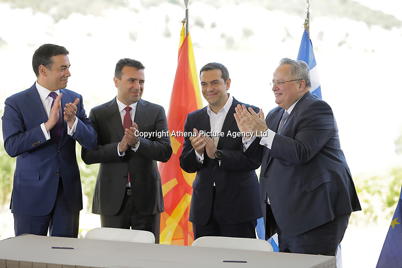 Pictured: (L-R) Nikola Dimitrov Minister of Foreign Affairs of FYROM, Zoran Zaevat, Prime Minister for FYROM, Greek Prime Minister Alexis Tsipras, Greek foreign minister Nikos Kotzias at Prespa Lake in northern Greece. Sunday 17 June 2018<br /> Re: Greece and the Former Yugoslav Republic Of Macedonia (FYROM) have signed a deal that aims to settle a decades-long dispute over the country's name.<br /> Under the agreement, Greece's neighbour will be known as North Macedonia.<br /> Heated rows over Macedonia's name have been going on since the break-up of the former Yugoslavia, of which it was a part, and have held up Macedonia's entry to Nato and the EU.<br /> Greece has long argued that by using the name Macedonia, its neighbour was implying it had a claim on the northern Greek province also called Macedonia.<br /> The two countries' leaders, Mr Tsipras and his Macedonian counterpart Zoran Zaev announced the deal on Tuesday and have pressed ahead despite protests.<br /> The two countries' foreign ministers signed the deal on Lake Prespa on Greece's northern border on Sunday.<br /> The agreement still needs to be approved by both parliaments and by a referendum in Macedonia.