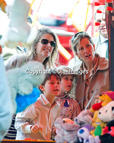 """LADY LOUISE WINDSOR AND MUM SOPHIE, COUNTESS OF WESSEX.enjoy a family day out at the Royal Windsor Horse Show..Lady Louise spent some time in the fairground trying her hand at darts_14/05/2011.Mandatory Photo Credit: ©DIasImages..**ALL FEES PAYABLE TO: """"NEWSPIX INTERNATIONAL""""**..PHOTO CREDIT MANDATORY!!: ©DiasImages/NEWSPIX INTERNATIONAL(Failure to credit will incur a surcharge of 100% of reproduction fees)..IMMEDIATE CONFIRMATION OF USAGE REQUIRED:.Newspix International, 31 Chinnery Hill, Bishop's Stortford, ENGLAND CM23 3PS.Tel:+441279 324672  ; Fax: +441279656877.Mobile:  0777568 1153.e-mail: info@newspixinternational.co.uk"""