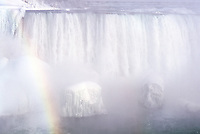USA, New York, Niagara Falls, Niagara Falls in winter with rainbow