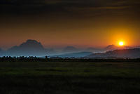 Buffalo Valley, just east of Grand Teton National Park provides the setting for a beautiful sunset behind Mt. Moran and the Teton Range.