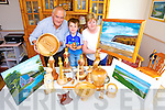 Peggy Casey and her husband Philip, pictured with their grandson Cody getting some of their crafts ready for the annual Crafts Fair in Ballyheigue Community Centre on August 4th.