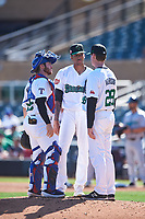 Surprise Saguaros relief pitcher Sterling Sharp (5) meets with Matt Whatley (25) and pitching coach Mike Anderson (28) during the Arizona Fall League Championship Game against the Salt River Rafters on October 26, 2019 at Salt River Fields at Talking Stick in Scottsdale, Arizona. The Rafters defeated the Saguaros 5-1. (Zachary Lucy/Four Seam Images)