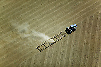 aerial photograph of a tractor plowing a field in the California Central Valley