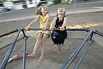 Girls play on a merry-go-round in Minden, Nev., July 1, 2005. .Photo by Cathleen Allison