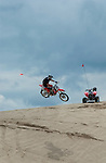 Dirt bikes jumping dunes on the Oregon sand dunes