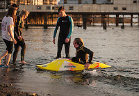 UK Weather: Aberystwyth, Ceredigion, West Wales. Sunday 8th May 2016 with temperatures topping 25 bought people out to enjoy the stunning sunset. Students take advantage of the weather to mess around in the water diving and canoeing.