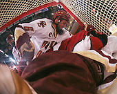 Benn Ferriero (BC 21) looks on as Tim Kunes (BC 6) and Matt McCollem (Harvard 23) join John Muse (BC 1) in the net. The Boston College Eagles defeated the Harvard University Crimson 6-5 in overtime on Monday, February 11, 2008, to win the 2008 Beanpot at the TD Banknorth Garden in Boston, Massachusetts.