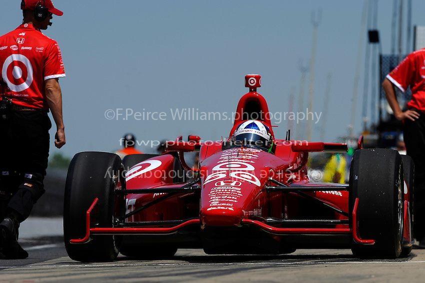 Dario Franchitti (#50) exits the pits for practice.