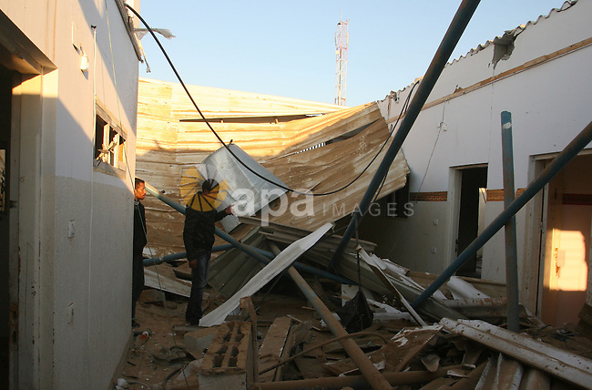 Palestinians inspect the damage in their house hit by a missile fired by Israeli air forces in the southern of Gaza strip town of Rafah, November 15, 2012. Several Palestinians were killed following a series of Israel's concurrent airstrikes on Gaza city, among them was Ahmed al-Jaabari, top commander of Hamas armed wing Al-Qassam brigades, and more than 150 others wounded, government's emergency services in the Gaza Strip said. Photo by Eyad Al Baba