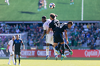 Portland, Oregon - Sunday October 6, 2019: Dairon Asprilla #27 challenges for a header with Guram Kashia #37 and Nick Lima #24 during a regular season match between Portland Timbers and San Jose Earthquakes at Providence Park in Portland, Oregon.