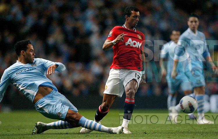 Manchester City's Joleon Lescott (L) in action with Manchester United's Nani..Barclays Premier League match between Manchester City and Manchester United at the Etihad Stadium, Manchester on the 30th April 2012..Sportimage +44 7980659747.picturedesk@sportimage.co.uk.http://www.sportimage.co.uk/.