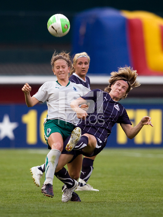 Sonia Bompastor (8) of the Washington Freedom collides with Carolyn Blank (3) of the Saint Louis Athletica at RFK Stadium in Washington, DC.  The Washington Freedom defeated Saint Louis Athletica, 3-1.