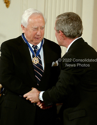 Washington, D.C. - December 15, 2006 -- David McCullough receives the Presidential Medal of Freedom  from United States President George W. Bush and first lady Laura Bush during a ceremony in the East Room of the White House on Friday, December 15, 2006.  The medal is the nation's highest civil award.  It may be awarded &quot;to any person who has made an especially meritorious contribution to (1) the security or national interests of the United States, or, (2) world peace, or (3) cultural or other significant public or private endeavors&quot;.  One of our Nation&rsquo;s most distinguished and honored historians, David McCullough has taken his own place in American history.  His books have earned him the respect of general audiences and scholars alike and have received numerous awards, including two National Book Awards and two Pulitzer Prizes.  The author of rigorous works on Harry Truman, John Adams, and the young Theodore Roosevelt, he is one of our foremost authorities on the American Presidency.  The United States honors David McCullough for his lifelong efforts to document the people, places, and events that have shaped America.<br /> Credit: Ron Sachs / CNP