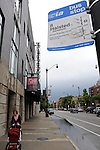 A woman walks passed the Steppenwolf Theater, where actors including John Malkovich, Martha Plimpton and Gary Sinise, are members of the ensemble, in Chicago, Illinois on June 19, 2009.