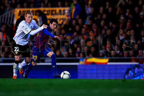 01.02.2012. Mestalla Stadium. Valencia CF versus FC Barcelona. First Leg semi finals of Copa del Rey tournament. Jeremy Mathieu (l) of Valencia CF challenges Isaac Cuenca (r) of FC Barcelona. Valencia CF versus FC Barcelona Copa del Rey tournament.
