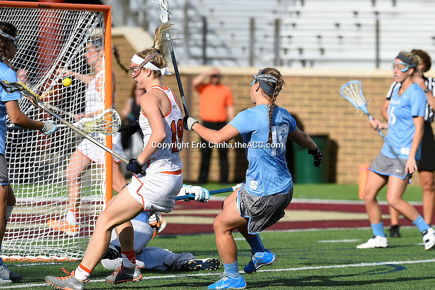 Syracuse's Katie Webster (18) scores a goal during the 2014 ACC Women's Lacrosse Semifinals in Boston, MA, Friday, April 25, 2014. (Photo by Eric Canha,<br /> theACC.com)