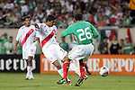 June 08 2008:  Rinaldo Cruzado (20) of Peru takes a shot on goal as Patricio Araujo (CD Guadalajara) (26) of Mexico defends.  During the third and final match of Mexico's 2008 USA Tour in preparation for qualification for FIFA's 2010 World Cup, the national soccer team of Mexico defeated Peru 4-0 at Soldier Field, in Chicago, IL.