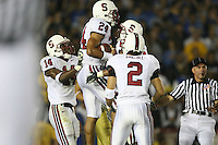 1 October 2006: Trevor Hooper celebrates with Tim Sims and Nick Sanchez (in foreground) during Stanford's 31-0 loss to UCLA at the Rose Bowl in Pasadena, CA.