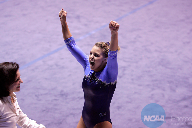 27 APR 2007: Janelle Dantzscher of UCLA celebrates after competing in the floor exercise during the Division I Women's Gymnastics Team Championship held at the Jon M. Huntsman Center on the University of Utah campus in Salt Lake City, Ut. Dantzscher finished the competition with a 9.875 score. Jaren Wilkey/NCAA Photos