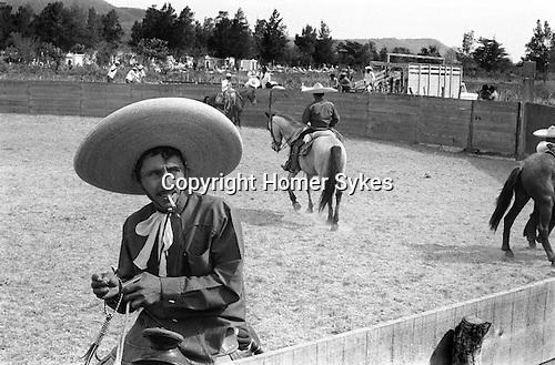 Village rodeo, Charro wearing huge sombrero Rodeo Mexico 1973.