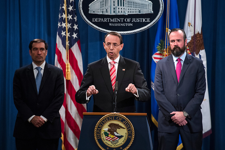 UNITED STATES - JULY 13: Deputy Attorney General Rod Rosenstein conducts a news conference at the Department of Justice announcing the indictment of twelve Russian nationals who are alleged to have interfered in the 2016 election on July 13, 2018. DOJ deputy attorneys John Demers, left, and Edward O' Callaghan, also appear. (Photo By Tom Williams/CQ Roll Call)