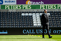 Sunday April 02 2017 <br /> Pictured:  Manager of Swansea City, Paul Clement inspects the pitch ahead of the game <br /> Re: Premier League match between Swansea City and Middlesbrough at The Liberty Stadium, Swansea, Wales, UK. SUnday 02 April 2017