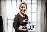 Michiko Sakurai with her AIBO at home in Tokyo. In 1999, Sony released a series of robotic pets called AIBO or Artificial Intelligence Robot. In 2006, they discontinued the AIBO line and then in 2014, discontinued all reparair services on the AIBO. A small community of AIBO owners still exists and a new repair service has emerged to help keep the AIBOs running.