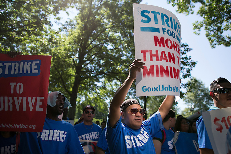 UNITED STATES - JULY 22: A protestor marches towards Upper Senate Park during a rally on Capitol Hill in Washington, Wednesday, July 22, 2015, to push for a raise to the minimum wage to $15 an hour. (Photo By Al Drago/CQ Roll Call)