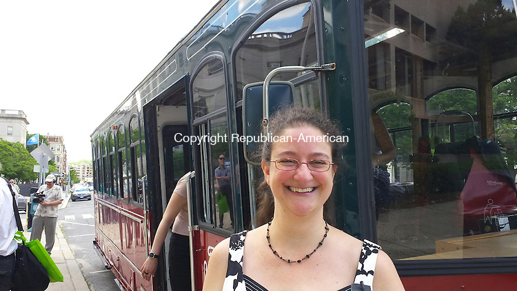 WATERBURY -- June 15, 2015 -- 12_NEW_061415MDP01 -- Local historian Raechel Guest with the trolley that toured part of the city Wednesday. Neighborhood Housing Services offered the tour, narrated by Guest, to showcase some of the work it's been doing in the NEWPAC, Crownbrook and WOW neighborhoods.
