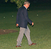 Washington, D.C. - September 2, 2005 -- United States President  George W. Bush walks towards the Oval Office with his head bowed after returning to the White House aboard Marine 1 following a tour of areas ravaged by Hurricane Katrina on September 2, 2005.  <br /> Credit: Ron Sachs / Pool via CNP