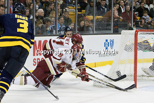 Jesse Todd (Merrimack - 16), Steven Whitney (BC - 21), Barry Almeida (BC - 9) - The Boston College Eagles defeated the Merrimack College Warriors 5-3 to win the Hockey East championship for the tenth time on Saturday, March 19, 2011, at TD Garden in Boston, Massachusetts.