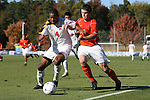 10 November 2010: Maryland's Ethan White (4) and Clemson's Austin Savage (5). The University of Maryland Terrapins defeated the Clemson University Tigers 2-1 at Koka Booth Stadium at WakeMed Soccer Park in Cary, North Carolina in an ACC Men's Soccer Tournament Quarterfinal game.