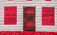 "NWA Democrat-Gazette/ANTHONY REYES @NWATONYR<br /> The ""Farm Girl Goes Red and White"" quilt, shows curtains and a flower box on the window as well as the outline of a door on a quilt Monday, April 3, 2017 at the Shiloh Museum in Springdale."