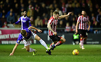Lincoln City's Michael O'Connor is fouled by Exeter City's Archie Collins<br /> <br /> Photographer Chris Vaughan/CameraSport<br /> <br /> The EFL Sky Bet League Two - Lincoln City v Exeter City - Tuesday 26th February 2019 - Sincil Bank - Lincoln<br /> <br /> World Copyright © 2019 CameraSport. All rights reserved. 43 Linden Ave. Countesthorpe. Leicester. England. LE8 5PG - Tel: +44 (0) 116 277 4147 - admin@camerasport.com - www.camerasport.com